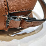 かばん修理 バッグ修理 ブランドバッグ修理 ゲス GUESS ショルダーバッグのベルト元の修理